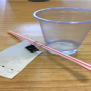 plastic cup a straw and paper